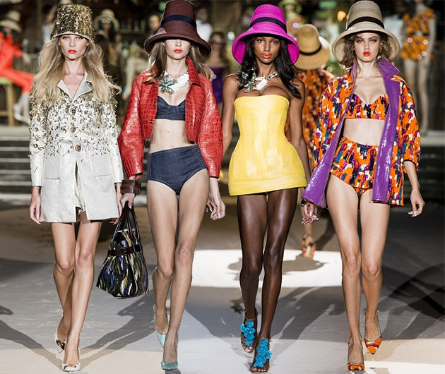 Model 2nd from right wears Dsquared dress with pink lampshade hat