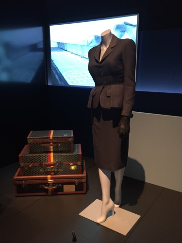Christian Dior day suit worn by Marlene Dietrich arriving in New York on board the Queen Elizabeth in 1960 and luggage previously belonging to the Duke of Windsor, 1940s
